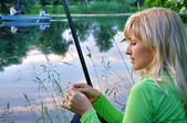 Fisherwoman on the river — Stock Photo