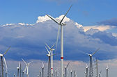 Wind-powered generators against a blue sky — Stockfoto