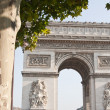 View of the Arc de Triomphe in Paris, France. - Stock Photo