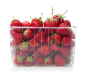 Fresh strawberries in plastic box on white. — Stock Photo