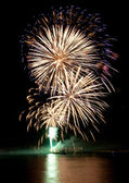 Beautiful colorful fireworks in night sky. — Stock Photo