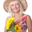 A woman with yellow flowers. — Stock Photo
