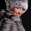 Beautiful young woman in a fur hat — Stock Photo