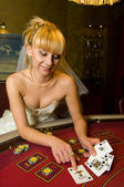 Lovely bride playing cards — Stock Photo
