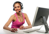 Pretty girl works on a computer — Stock Photo