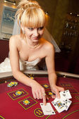 Funny bride playing cards — Stock Photo