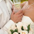Two glasses of champagne against lovers — Stock Photo