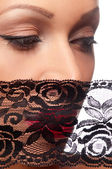 Beautiful woman in a black veil — Stock Photo