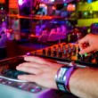Dj mixes track in nightclub at party — Stock Photo #6568300