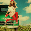 Beauty young woman with curly hairs on retro green car - Stock Photo