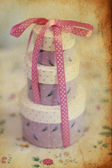 Vintage pretty sweet box with a pink bow — Stock Photo
