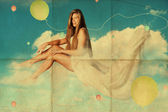 Sexy woman on clouds in the sky — Stock Photo