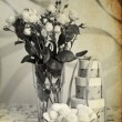 Stock Photo: Desaturated roses in glas
