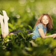 Beauty woman in a green grass - Stock Photo