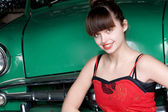 Beauty young woman with green retro car — Stock Photo