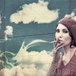 Stock Photo: Beuty young smoking woman