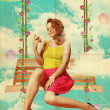 Beautiful young woman in clouds — Stock Photo