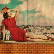 Stock Photo: Beautiful young womin red dress on roof