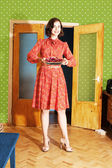 Beautiful woman in red dress with pie — Stock Photo