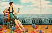 Piękna kobieta w niebieska sukienka blisko morza — Zdjęcie stockowe