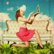 Beautiful woman with book in clouds — Stockfoto
