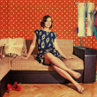 Beautiful woman in retro room with fashion clothes — Stock Photo