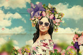 Beautiful young woman with flowers on the head, art collage — Stock Photo