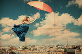 Art collage with beautiful young woman with umbrella — Stock Photo