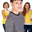 Smiling young kid in focus with family in the background — Stock Photo