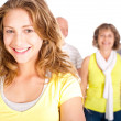 Gorgeous woman in focus with her mom in the background — Stock Photo