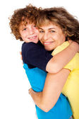 Grandmother and grandson hugging each other — Stock Photo