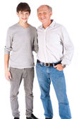 Teenager and grandfather, in studio — Stock Photo
