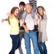 Thumbs-up family posing in style — Stock Photo