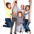 Stock Photo: Happy family jumping high
