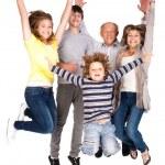 Happy family jumping high — Stock Photo