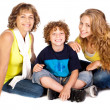Family having fun on the floor, smiling at camera — Stock Photo #5944344