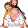 Grandparent lying on floor with grandson - Stock Photo