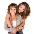 Pretty daughter hugging her mom from back — Stock Photo