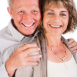 Affectionate old man hugging his wife from behind - Stock Photo