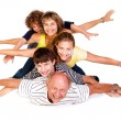 Stock Photo: Cheerful family having fun in the studio
