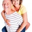 Senior man giving woman piggyback ride — Stock Photo #5944441