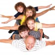 Cheerful family having fun in the studio - Stock Photo