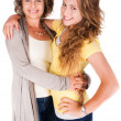 Mother and daughter embracing each other - Foto Stock