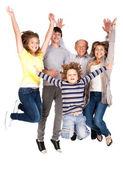 Lycklig familj hoppar högt — Stockfoto