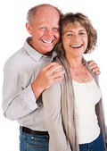Happy senior couple smiling at camera — Stock fotografie