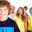 Adorable young kid in focus with family in the background — Stock Photo