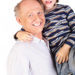 Grandfather and grandson smiling — Stock Photo
