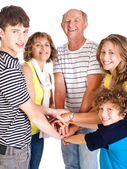 United happy family smiling at camera — Stock Photo