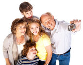 Family together taking self-portrait — Stock Photo