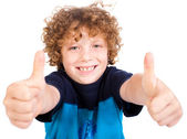 Smilling cute little boy gesturing thumbs up — Stock Photo